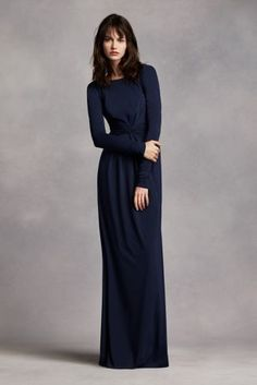 Stunning and elegant, Stand out in this lovely long sleeve jersey dress! Long sleeve bodice with scoop neckline features plunging V-back. Long soft jersey skirt has eye catching knot twist detail at waist. Fully lined. Back zipper. Imported polyester. Dry clean only.