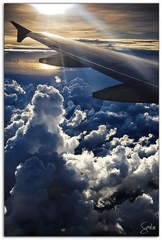 Aircraft Wings View Photography - wing of and Airbus - note the wingtip fences. Boeing's have clean wingtip (i.e nothing on it), or winglets (747-400), blended winglets (737 Next Gen, BBJ) or raked wingtips (767-400ER, GE90-115B-powered 777's & 787). Two prior Airbus jet's had 747-400 -style winglets - the A330 & A340. On future A320's, Sharklets will be a key feature.