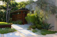 More pavers and gravel + drought-tolerant plants