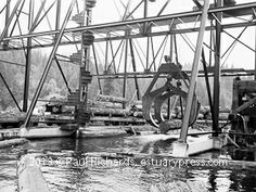 1960, Humboldt County, CA. Crain transferring logs to the river.
