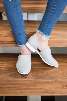 A perforated, pointy toe and adorable stacked heel make these flats the perfect summertime shoe. All man made materials. They fit a little big; we recommend ordering a half size smaller than what you