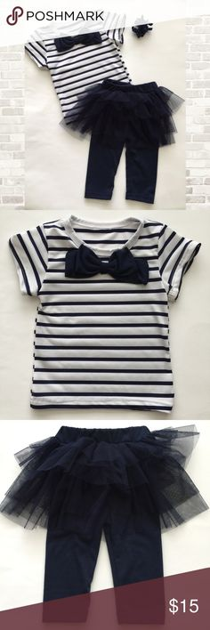 Adorable 2 Piece Outfit Size 12 months navy and white short sleeve top with navy bow design and matching navy pants with attached tutu skirt. Never worn! Absolutely adorable  Matching Sets