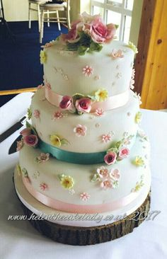 Beautiful sugar flowers  made by myself for customers own cake. 3 tier blossom wedding cake.