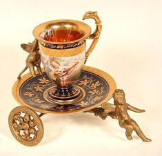 Gold demitasse cup and saucer on a rolling server cart