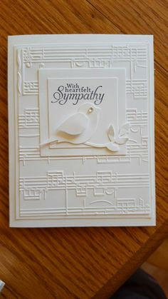 handmade sympathy card ... white on white ... embossing folder sheet music background ... punched bird on a branch ... lovely card!