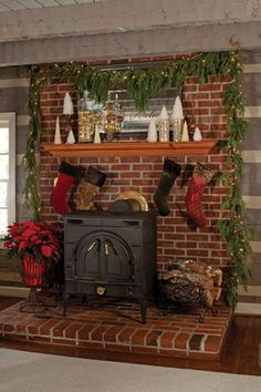 wood burning stove cottage | and faux fur trim hang from this mantel over an old wood-burning stove ...