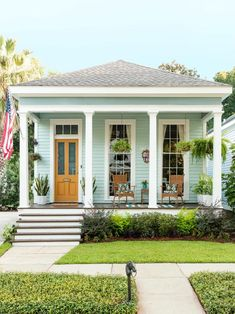 A baby blue shotgun home from HGTV Magazine A baby blue shotgun home from HGTV Magazine,HGTV Outdoor Spaces This adorable house in Alabama is decorated with an orange door, wicker chairs and blue accessories. Exterior House Colors, Exterior Design, Exterior Paint, House Ideas Exterior, Beach Bungalow Exterior, Outside House Paint Colors, Beach House Colors, Exterior Shutters, Style At Home