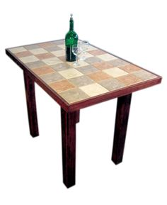 """6"""" x 6"""" floor tiles make a unique & durable table top. There are 60 rust, cream and slate coloured tiles on this table, grouted, sealed and framed with 2-inch pine, stained in red mahogany. $660"""