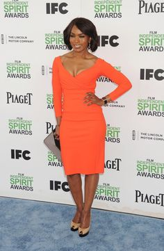 Angela Bassett put her curves to work in a orange figure-hugging dress at the  2014 Film Independent Spirit Awards on March 1, 2014.