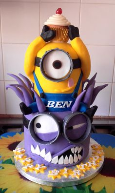 Minion cake 2 tier, chocolate and plain sponge, yellow minion and evil minion.