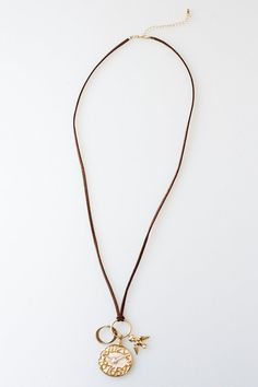 """Made from 100% bronze and 100% hand cut leather chain. The necklace comes in either gold face and silver numbers and charms or silver face and gold numbers and charms. This high quality, light weight necklace will be a conversation piece and a touch of class to any outfit.    16"""" long chain, 1 1/2"""" big charm and .75"""" smaller charms   Clock Necklace by Crystal Avenue. Accessories - Jewelry - Necklaces San Diego, California"""