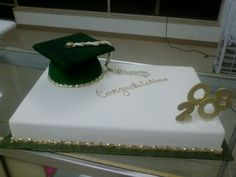 Graduation  - This was a 11x15 cake with a cap. The cap is a 1/2 sports ball pan, and a piece of cardboard cover in fondant. Tassel is hand made and hand painted. Gumpaste #'s and painted in gold. School colors are green and gold. Fun cake to make. TYFL