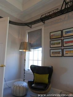 boys room with ceiling train track