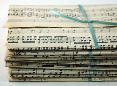 using old music sheets for envelopes. So sweet!