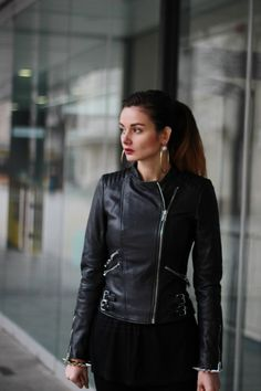 All black outfit with some accessories from the future- Best Sci Fi Tv Series of 2015