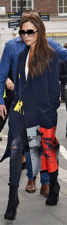 Victoria Beckham's black ankle boots, gray skinny jeans, and print coat