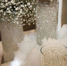 clear gel balls, this adds texture and since they soak up all the water, no need for water in the vases! You can make them in every color too. This is so pretty, perfect for a winter wonderland theme or a glam look since they also pass as diamonds!