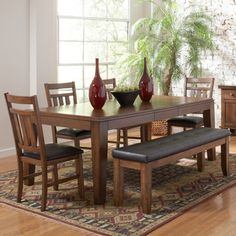 @Overstock - For your casual dining space, the Kai dining set provides ample seating for your family and friends. The horizontal and vertical slat supports form each chair back in a fun, contemporary design.http://www.overstock.com/Home-Garden/Kai-6-piece-Mission-Oak-Dining-Set-With-Butterfly-Leaf/5971130/product.html?CID=214117 $1,003.99