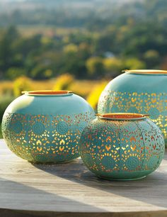 Add a dash of color with our Isla Lanterns. The three lanterns feature a rich turquoise patina on the outside, gold finish on the inside, and a metal-cut pattern inspired by Moroccan tiles.