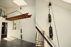 stairs that lift up on a pulley system. The counter weights used are old window weights that had been discarded [due to the] modern windows replacing them. The wood is also longleaf pine salvaged from an old building.