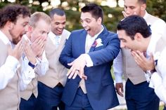 Hahahaa the groom imitates the bride by showing off his wedding band to his groomsmen ~ priceless