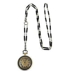 Cartier Platinum Yellow Gold Diamond Black Enamel Pendant Watch Necklace | From a unique collection of vintage more-necklaces at https://luigi.1stdibs.com/jewelry/necklaces/more-necklaces/