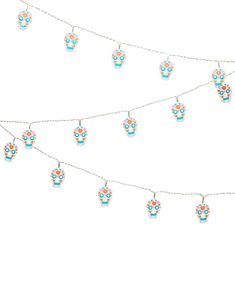 Sugar Skull String Lights - Light up the night with the acrylic Sugar Skull String Lights. Inspired by our iconic sugar skull designs, give your home Day of the Dead vibes with these playful lights.