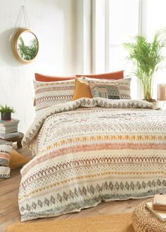 Bring earthy tones to your bedroom with this aztec design duvet cover, complete in a mix of rust, green, ochre and brown. Combining the natural comfort...