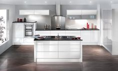 Cut Price Kitchens White Sculptured Gloss Kitchen. A minimalist handless look. Highly fashionable yet practical and easy to clean. Curved and tall wall unit options for a designed statement. Comprising of 18mm thick carcases, soft-close hinges and benefits from 330mm deep wall cabinets. www.cutpricekitchens.co.uk