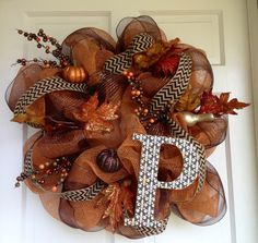 Deco Mesh Burlap Fall Wreath- kind of gaudy, but I kind of like it!