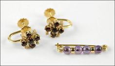 A PAIR OF GARNET AND 14 KARAT YELLOW GOLD EARRINGS. Lot 150-7239 #jewelry
