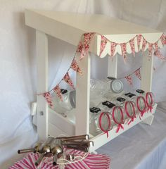 Our DIY table top candy cart for hire from £50, includes jars, centrepiece glass bowl, scoops, tongs.  Ribbons and bags in theme colour upon request.  Can also supply with sweets, choice of 8 from list of 25.  Contact us for more information.
