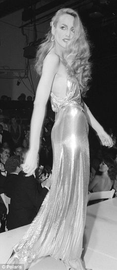 The glamorous Jerry Hall shimmers on the runway, 1970's