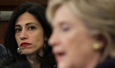 The ever-present companion, Huma, never takes her eyes off Hillary.