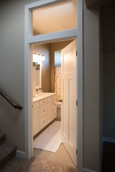 Interior Doors | transoms are the easiest way to let natural light flow through interior rooms.  this one was added a-top a classic, three-panel Craftsman door | Bayer Built Woodworks, Inc.