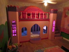 Bed we built Ryley for Christmas this year. TV, Fish Tank (w/ access), spiral stair case, towers, etc. She Loves IT!