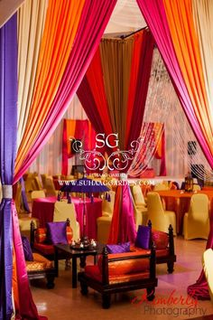 Suhaag Garden, Florida Indian wedding decorator, Mehndi, colorful drapery and linens, indoor cabanas, low rise chairs