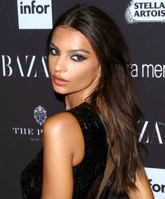 Emily Ratajkowski: To mimic the allure of Emily Ratajkowski's long and windswept layers, work a shine-inducing leave-in conditioner into damp hair before letting it air-dry. If your locks need some extra va-va volume once they've dried, finish with a light-handed spritz of sea salt or texturizing spray to create some body while maintaining the low-maintenance, undone appeal.