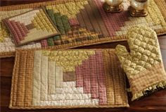 "Walnut Grove Log Cabin Block Runner - 13x48"" by Nancy's Nook. $14.95. All cloth items in our collections are 100% preshrunk cotton. All braided items (like rugs, baskets, etc.) are 100% jute. See Product Description below for more details!. High end quality and workmanship!. Extensive line of matching items and accessories available! (Search by Collection name). Product measurements and additional details listed in title and/or Product Description below.. Country charming hue..."