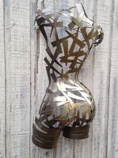 Metal wall art torso hand crafted by Holly Lentz on Etsy, $469.00