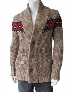 Melange brown wool and cashmer cardigan, cuello de chal, cierre con botones moteados, precious knit realized in different points: ribbed, waving, squared and chianed, pockets insert in the tissue, decoration of star of Christmas in the arms. #Men #knitwear