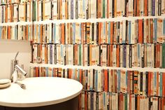 Publisher Jane Friedman's bathroom, with book wallpaper.