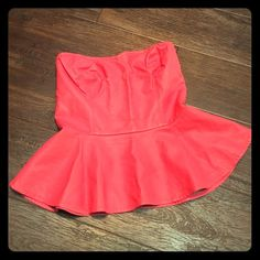 Pink strapless top Great condition, pink strapless pleather tube top, button down back, small slit at the bottom of the back (as shown in picture). Bust 12. Length 141/2. No holds. No trades. Fast shipping. Forever 21 Tops Blouses