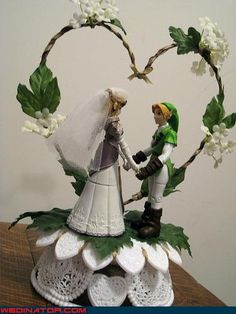 almost identical to our geek wedding cake topper...someone else out there is just as rad as us!!