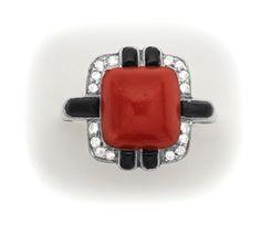 Art Deco Coral, onyx, diamond and platinum ring.                        E. M. Gattle & Co.