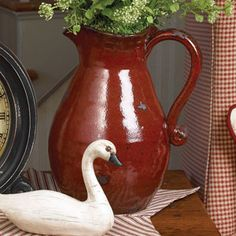 Red ceramic pitcher ~ love this red brick color