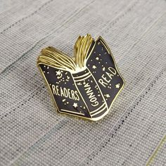 A shiny little enamel pin badge featuring a readers gonna read book design. A perfect gift for a book lover.  Adorn your denim jacket, tote bag,