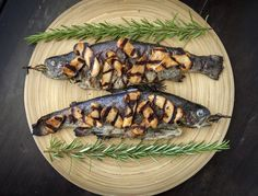 Grilled Trout with Rosemary and Sake-glazed Matsutake Mushrooms. Perhaps it's some half-forgotten memory from our hunter-gatherer past; fat trout, snatched from a cold, fast-running stream, cooked together with mushrooms found nearby on the moist riverbank, must have seemed like a magical union of earth and water. Add a third element, fire, and you've got dinner!