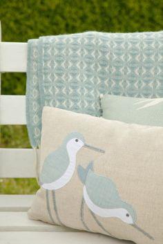 Blue wool throw and dunlin cushion.   https://folksy.com/items/6671968-Handmade-seabirds-Cushion-in-pastel-blues