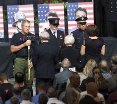 """Firefighters present a bronzed Pulaski tool, an American flag and an Arizona flag to family members of the 19 Granite Mountain Hotshots who died fighting the Yarnell Hill fire June 30. The Pulaski tool is a hand tool that has been used in wildland firefighting for more than 100 years, and represents the wildland firefighting community. Tuesday's ceremony, """"Brothers – A Celebration of Life,"""" took place at Tim's Toyota Center in Prescott Valley.  See dCourier.com for photo galleries of the…"""